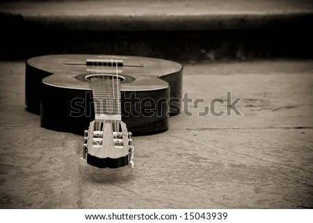 Spanish guitar in sepia - stock photo