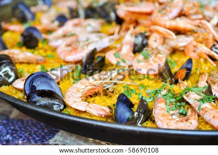 Spanish Paella Close Up with Shrimp and Clams - stock photo