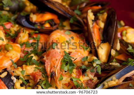Spanish paella, traditional recipe from Valencia. - stock photo