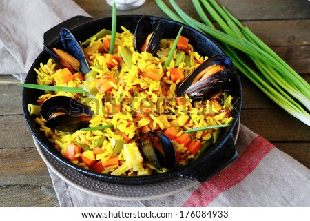Spanish paella with mussels, food closeup - stock photo