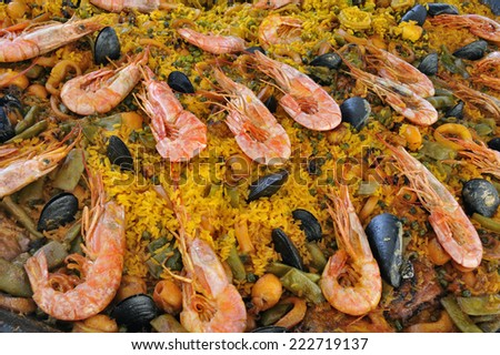 Spanish paella with seafood prepared on the traditional way - stock photo
