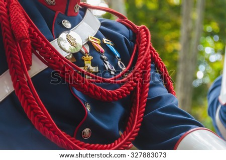 Spanish royal guard jacket with military awards and an aiguillette - stock photo