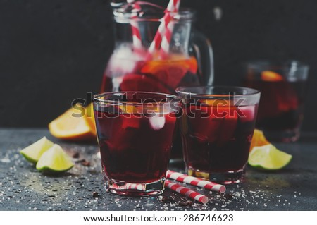 Spanish sangria with orange and lime, selective focus and toned image - stock photo