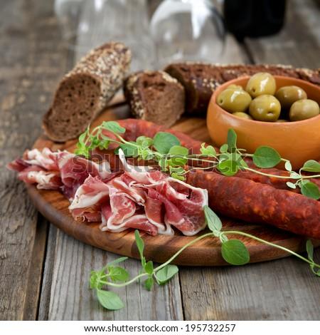 Spanish tapas - jamon, chorizo, olives - stock photo