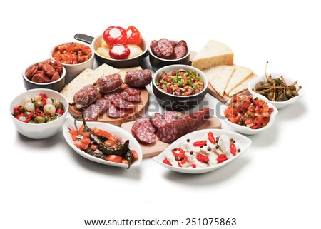 Spanish tapas or antipasto food, cold buffet appetizers isolated on white background - stock photo