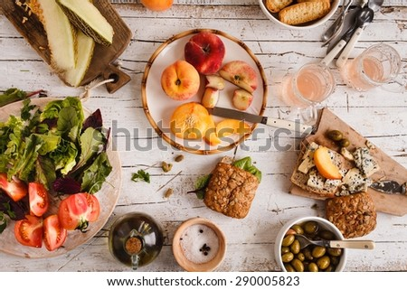 Spanish traditional dinner with fresh vegetables, blue cheese, grilled potatoes and  - stock photo