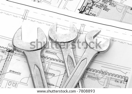 Spanners and house plan for construction or reconstruction - stock photo