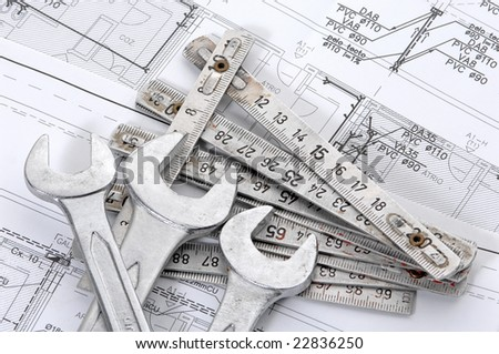 Spanners over house plan for construction or reconstruction - stock photo