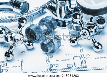 spare parts and tools lying on drawing for repair plumbing. toning image - stock photo