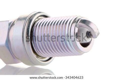Spark-plug on white reflective background - stock photo