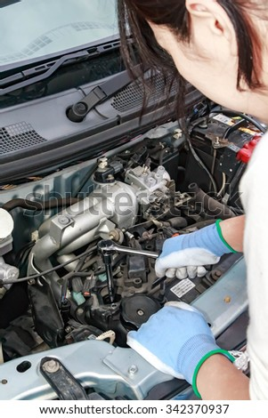 Spark plug replacement work - stock photo