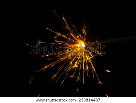 sparking Bengal fires on black background close-up  - stock photo