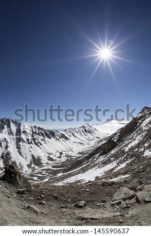 sparkle sun in a mountains, Ladakh, India - stock photo