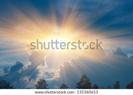 sparkle sun push through a dense clouds - stock photo
