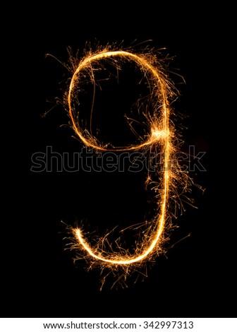 Sparkler firework light alphabet g (Small Letters) at night background - stock photo