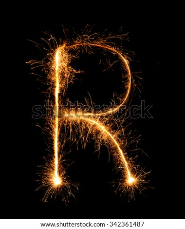 Sparkler firework light alphabet R (Capital Letters) at night background - stock photo