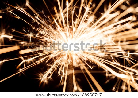 sparkler on black - stock photo