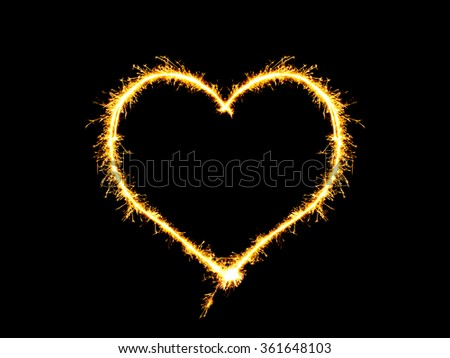 Sparklers heart on a black background - stock photo