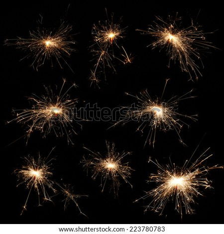 Sparklers on black background - stock photo