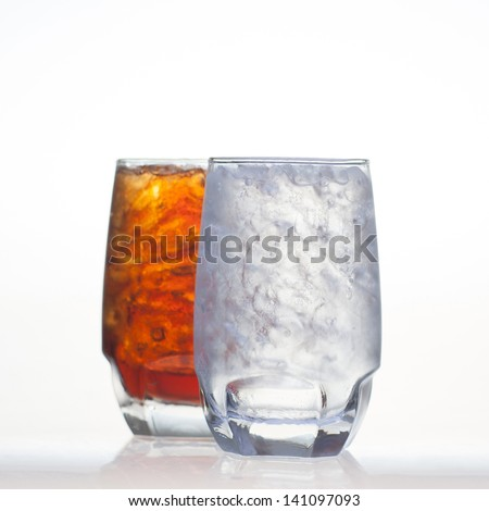 Sparkling cola drinks with sprite soda water and ice in glass isolated on white background - stock photo