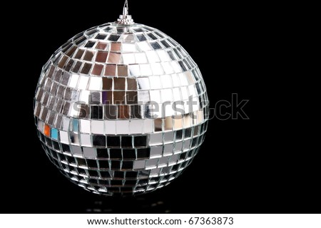 Sparkling glass disco ball isolated on black - stock photo