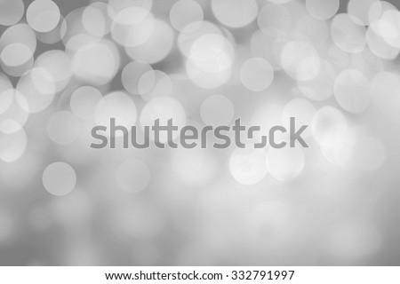 Sparkling Lights on grey background. Glitter Christmas Abstract bokeh