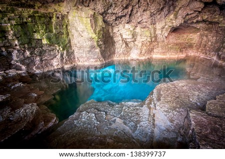Sparkling turquoise blue water of the Grotto at Bruce Peninsula National Park, Tobermory Ontario, Canada - stock photo