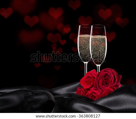 Sparkling valentine day with champagne and roses, close-up. - stock photo