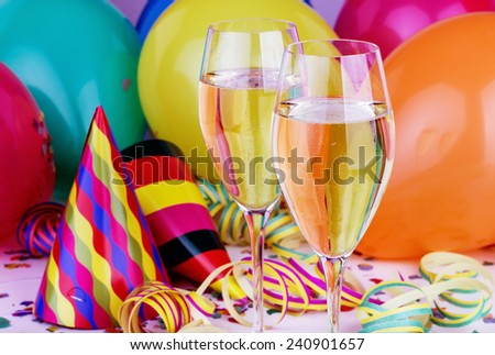 Sparkling wine, streamers, confetti and party hat/party/carnival - stock photo