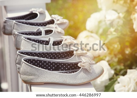 Sparkly bridesmaid shoes lined up in the sunlight.  - stock photo