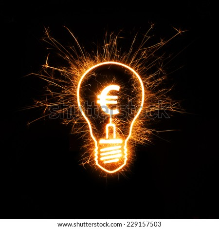 Sparkly light bulb and euro sign representing bright idea in finance-related concept. - stock photo