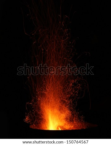 Sparks and Embers flying off a bonfire  - stock photo