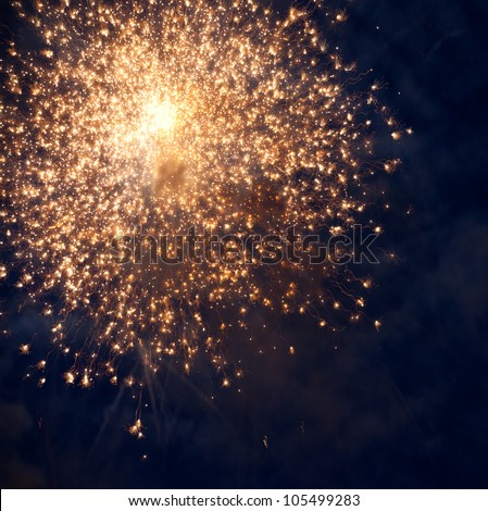 Sparks. Fireworks are a class of explosive pyrotechnic devices used for aesthetic and entertainment purposes. - stock photo