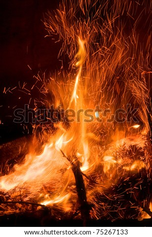 Sparks flying from a fire. - stock photo