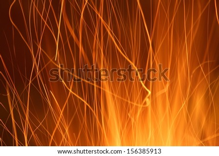 sparks from a fire light trail - stock photo