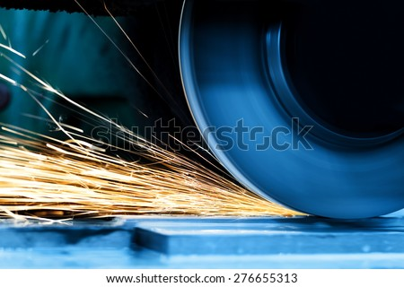 Sparks from grinding machine in workshop. Industrial background, industry. - stock photo
