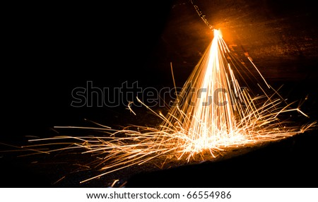 Sparks from welding of metal - stock photo