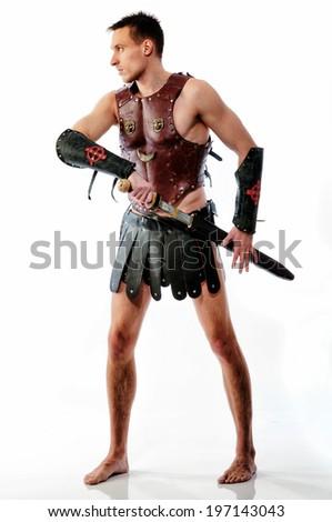 Spartan warrior preparing to battle on white background - stock photo