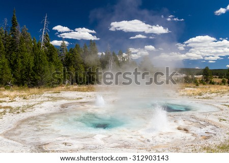 Spasmodic Geyser at upper geyser basin, Yellowstone National Park, Wyoming, USA - stock photo