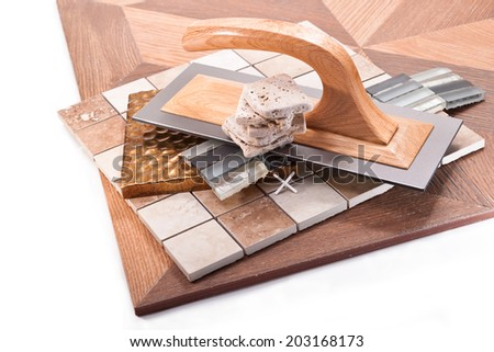 Spatula for leveling walls, decorative tiles for kitchens and baths pasting - stock photo