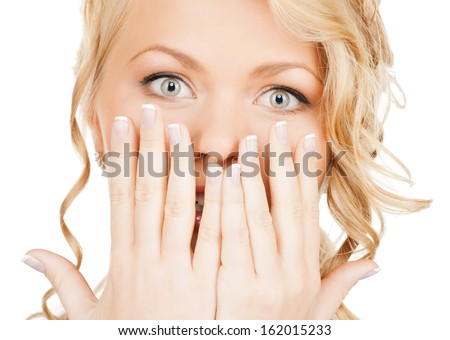 speak no evil concept - face of beautiful woman covering her mouth - stock photo