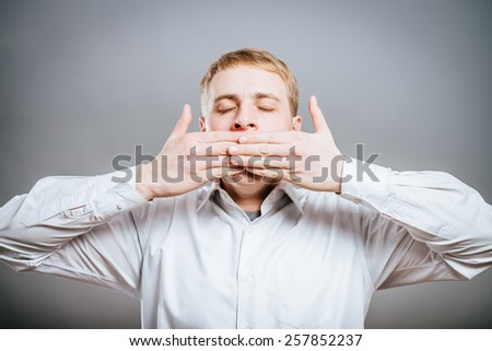 Speak no evil concept - Face of men covering his mouth. - stock photo