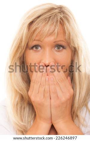 Speak no evil concept. Surprised woman face, covering her mouth with hands isolated - stock photo