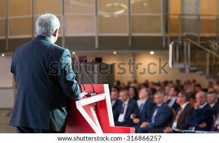 Speaker at Business Conference and Presentation. Audience at the conference hall. No recognizable faces - stock photo
