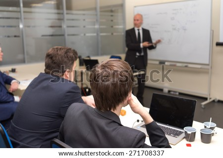 Speaker at business workshop and presentation. Audience at the conference room. - stock photo