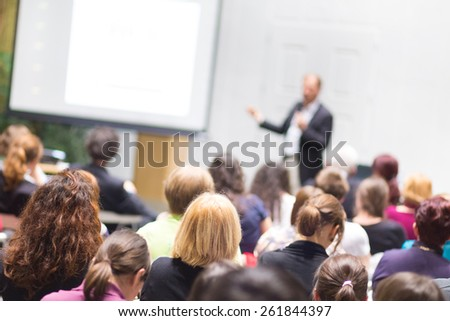 Speaker Giving a Talk at Business Meeting. Audience in the conference hall. Business and Entrepreneurship. Copy space on white board. - stock photo