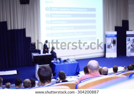 Speaker Giving a Talk at Business Meeting. People at the conference hall. Rear view - stock photo
