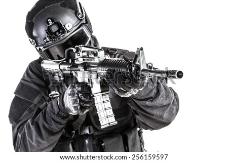 Spec ops police officer SWAT in black uniform and face mask - stock photo