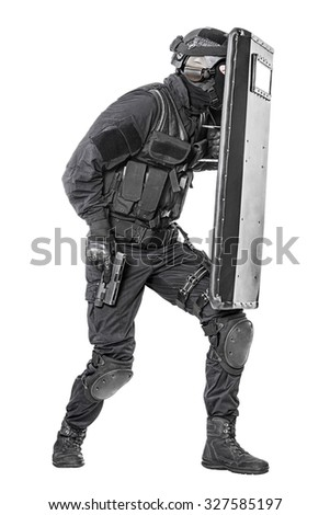 Spec ops police officer SWAT with ballistic shield studio shot - stock photo