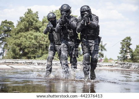 Spec ops police officers SWAT in the water - stock photo